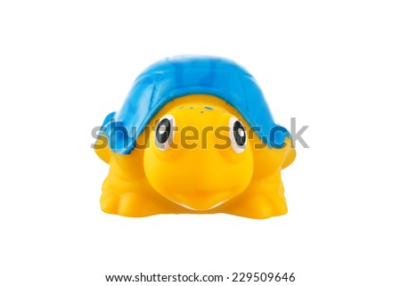 Yellow rubber turtle isolated on White Background  - stock photo