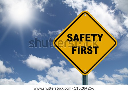 Yellow safety first roadsign - stock photo