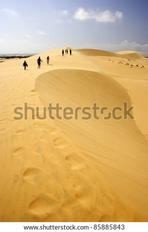 Yellow sand dunes in Mui Ne in South central Vietnam South East Asia - stock photo