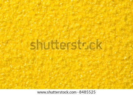 Yellow sandpaper for background and texture