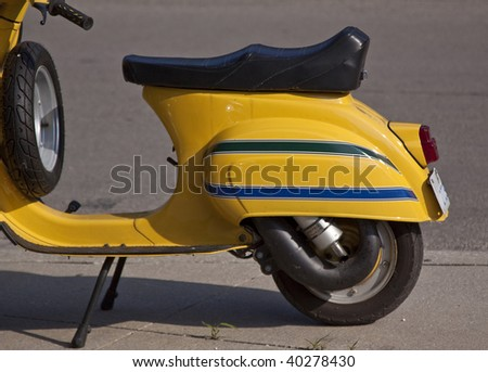 Yellow scooter - stock photo
