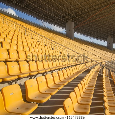 Yellow seat stadium - stock photo