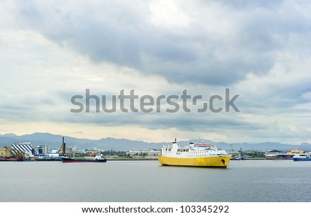 Yellow ship in industrial harbor. Cebu, Philippines