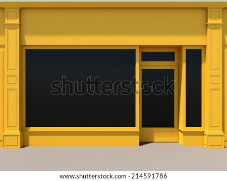 Yellow shopfront with large windows. Yellow store facade. - stock photo