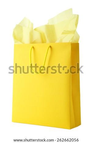 Yellow shopping bag isolated on white - stock photo