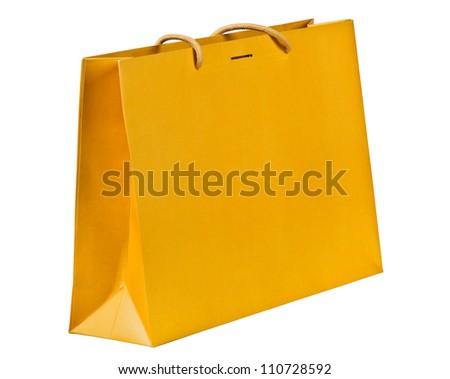 Yellow shopping bag on white. - stock photo