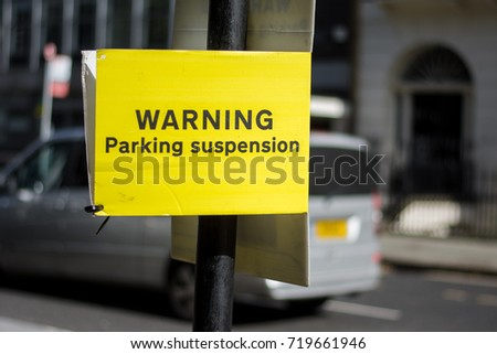 Yellow sign indicating suspension of car parking in London