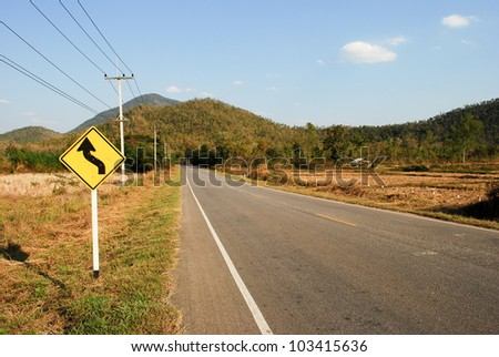 Yellow sign on the way - stock photo