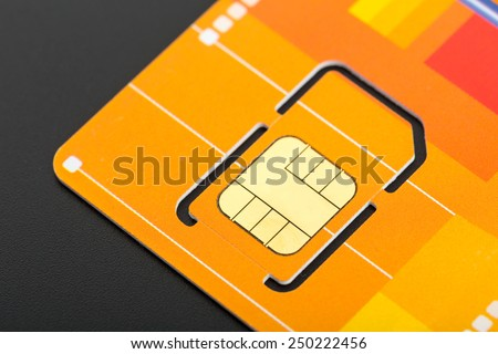 Yellow sim card - stock photo