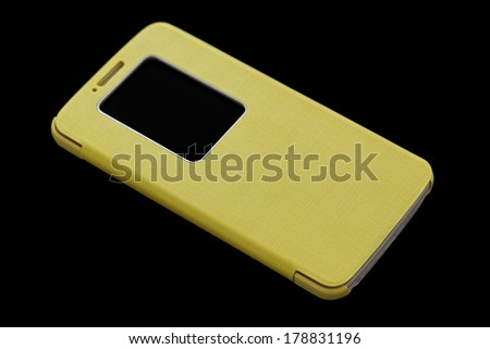 Yellow smart phone concept on dark background - stock photo