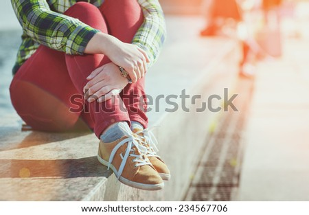 Yellow sneakers on girl legs in hipster style - stock photo