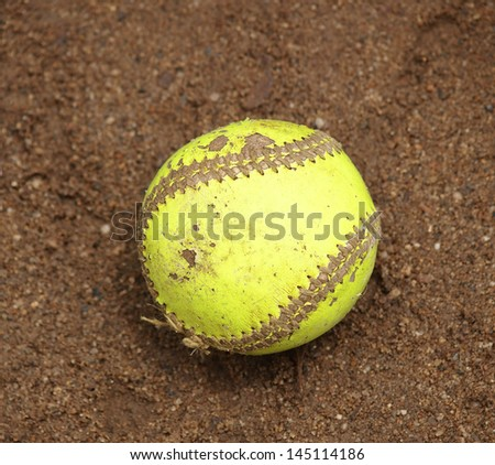 Yellow Softball Image Yellow Softball on Wet Sand