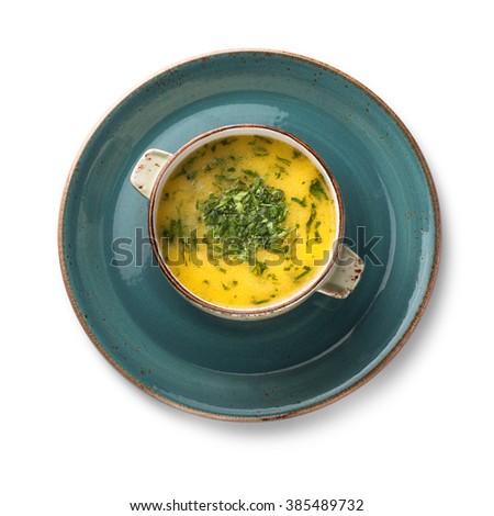 Yellow soup Chikirtma, isolated on white - stock photo
