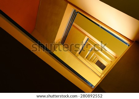 yellow spiral stair - stock photo