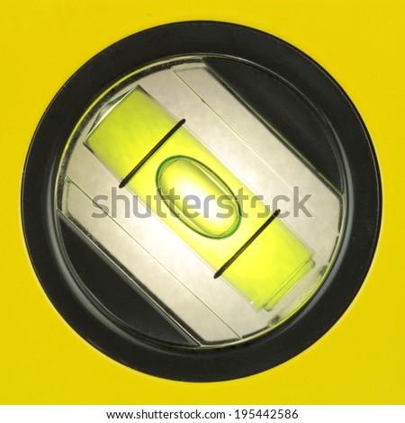 Yellow spirit level , macro image - stock photo