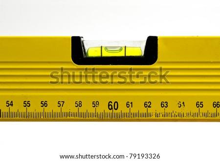 Yellow spirit level; well-used spirit level isolated against white ground - stock photo