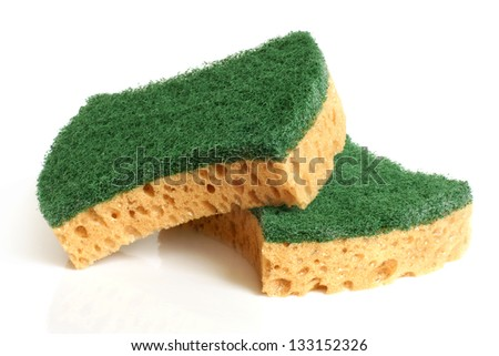 Yellow sponges on a white background - stock photo