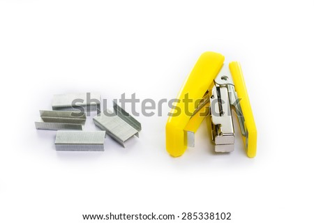 Yellow Stapler with staples wires on white background. - stock photo