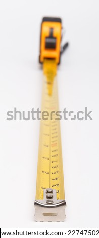 Yellow steel tape measure. Repair and building concept - stock photo