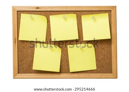 yellow sticky notes on cork  board - stock photo