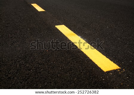 Yellow stripes on road