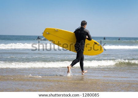 yellow surfboard - stock photo