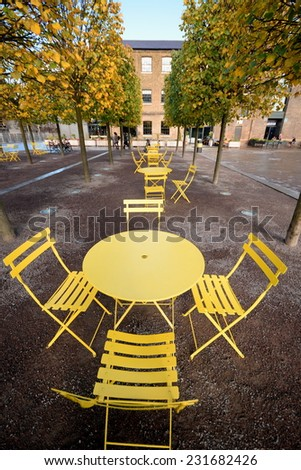 Yellow table with chairs - stock photo