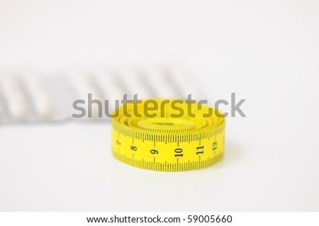 yellow tape and pills - stock photo