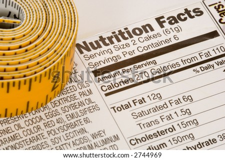 Yellow tape measure next to nutrition information on packaging in the USA - stock photo