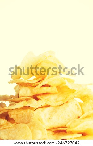 Yellow tasty but unhealthy potatoe chips.  - stock photo