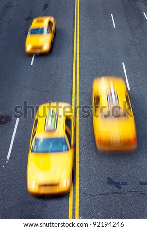 Yellow taxi cabs in motion in New York City - stock photo