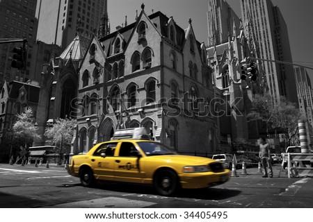 Yellow taxi in Manhattan, New York - stock photo