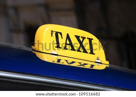 Yellow taxi sign in Havana, Cuba - stock photo