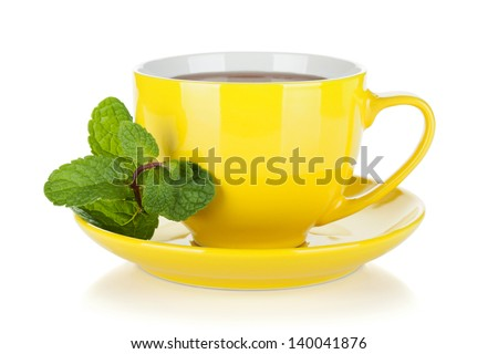 Yellow tea cup with mint. Isolated on white background - stock photo
