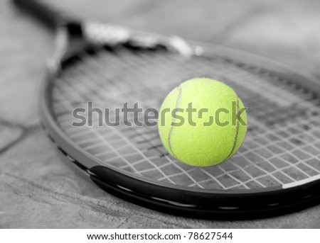 Yellow Tennis ball on a racket - stock photo