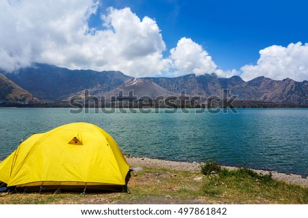 yellow tent at segara anak lake rinjani mount, indonesia