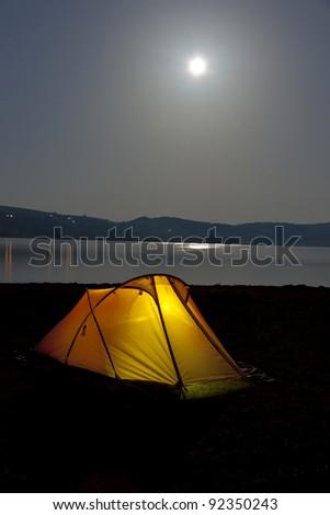 Yellow tent on coast of Vlasinsko lake in Serbia - Balkans at night. - stock photo