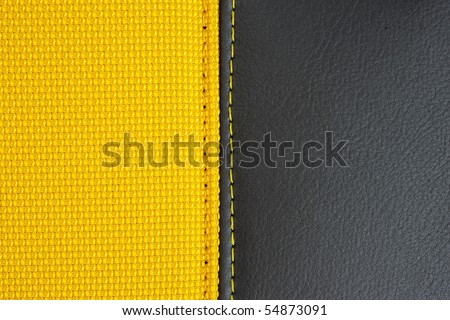 yellow textile and black leather texture - stock photo