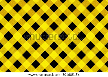 Yellow textured criss cross pattern on a black background - stock photo