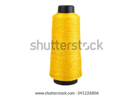yellow thread spool of white background, isolated background - stock photo