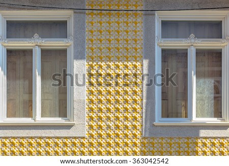 Yellow tile decoration in a Porto window. - stock photo