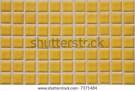 Yellow tiled wall of marble as background abstract texture - stock photo