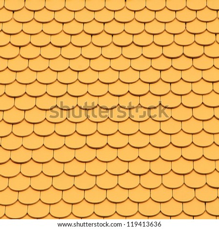 Yellow tiles roof, architecture background.