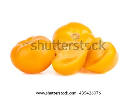 Yellow tomatoes isolated on white background - stock photo