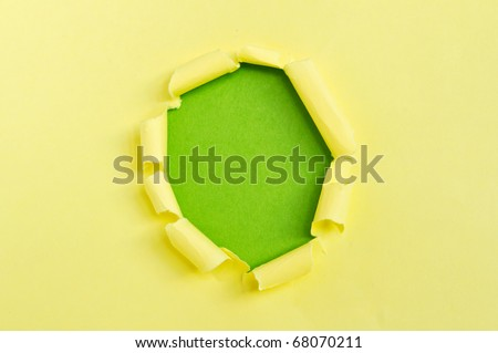 Yellow torn paper over green background