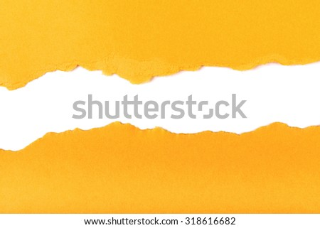 yellow torn paper with ripped edge copy space - stock photo