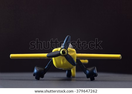 Yellow Toy Airplane - stock photo