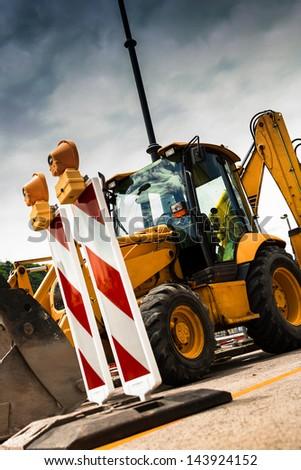 Yellow tractor - stock photo
