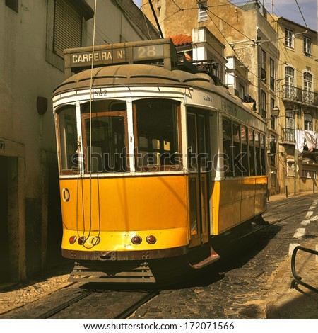 Yellow tram in Lisbon, Portugal - stock photo