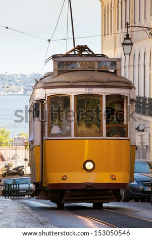 Yellow tram on Lisbon street. Tram is a popular way to travel in Lisbon city.